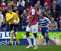 Photo: Daniel Hambury.<br />Reading v Arsenal. The Barclays Premiership. 22/10/2006.<br />Reading's Stephen Hunt is pointed at by Arsenal's 'keeper Jens Lehman after leaping over the German.