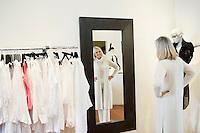 Senior woman looking at herself in mirror