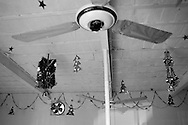 Christmas decorations hang on the ceiling of a Protestant church in preparation of the Christmas celebrations in the French Colony slum.