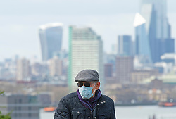 ©Licensed to London News Pictures 20/03/2020<br /> Greenwich, UK. Coronavirus threat London. An elderly man with a protective face mask on in Greenwich Park, Greenwich, London. Photo credit: Grant Falvey/LNP