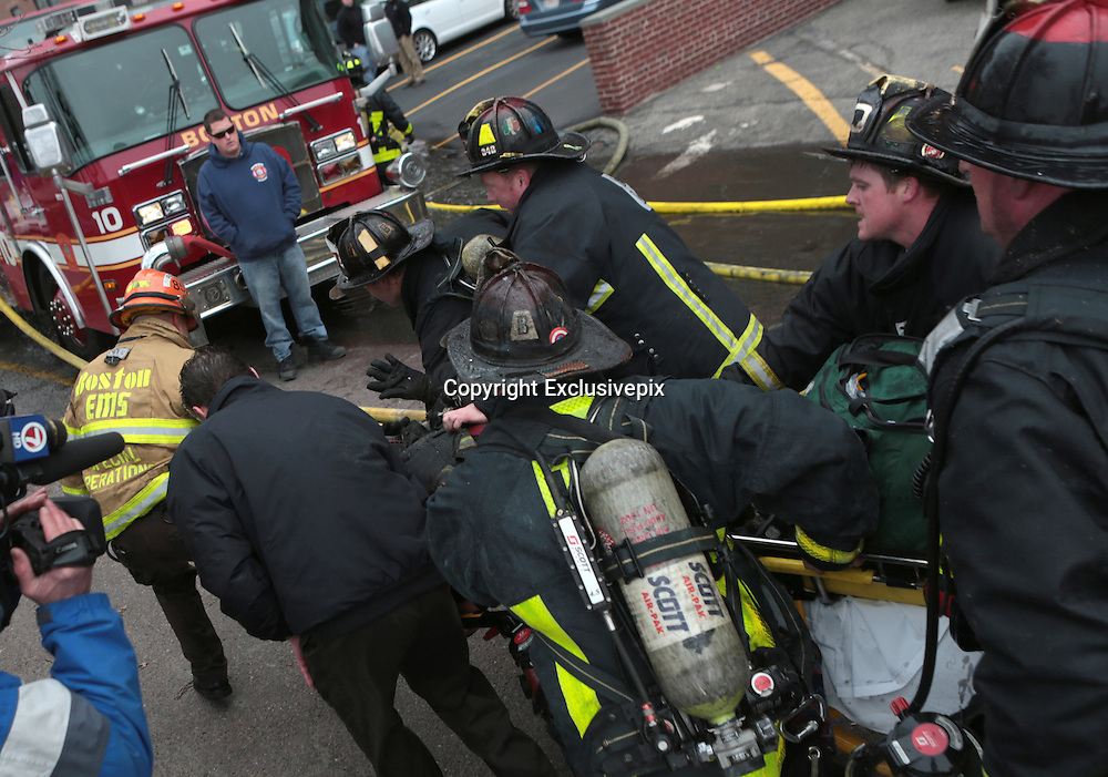 Mar 26, 2014 - Boston, Massachusetts, U.S. - <br /> <br /> Two Firefighters Killed in Boston Brownstone Blaze<br /> <br /> More than 150 Boston Firefighters battle a fast moving fire on Beacon Street where more than 15 individuals were transported from the scene to local hospitals. Seriously hurt firefighters are reported to be among those injured. <br /> &copy;Exclusivepix