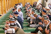 Uzbekistan, Khiva, Friday prayer at a mosque.