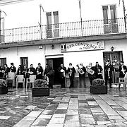 Italy, Basilicata- Closing day of S. Francesco feast: the marchband ready, shelting from the rain  © 2012 Mama2