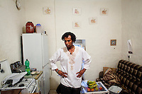 """Zurrieq, Malta - 19 August, 2012: Shami Taha Mohammed, a 29 years old Sudanese immigrant who arrived in Malta in 2004, is in the kitchen of the farm house he shares with other Sub-Saharan migrants before celebrating the end of Ramadan with Sudanese and Maltese friends in Zurrieq, Malta,  on 19 August, 2012. Shami co-founded the Migrants' 'Network for Equality' in 2010, after one migrant committed suicide, to give a 'voice' to the sub-saharan community. He works in a company specialized in ship maintenance. Speaking about integration of the migrants in the Maltese society, he says: """"We're integrated with the Maltese, but there's racism at the top, among those who should be taking care of the refugees"""". He continues speakng about the amount of African workers in construction companies: """"The Maltese don't like to work in construction. We built the new hospital!"""".. Shami sends back money to his family in Sudan, to his mother, two sisters and brother. He's currently writing a book called """"Get on the boat"""". """"Outside our country we are nobody. We are just black people"""", Shami says. Upon his arrival in Malta from Libya in 2004, Shami was in a detention center for 6 months.<br /> <br /> Gianni Cipriano for The New York Times"""
