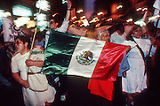 MEXICO CITY, DF, MEXICO: Women carry the Mexican flag through the historic area of Mexico City during a political protest.  PHOTO © JACK KURTZ  family  culture  women patriotism