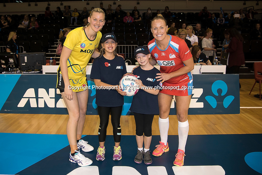 Pulse's captain Katrina Grant (L) with future captain Wikitoria Doyle (Center (L) and Alicia Houston (Center R) also Swifts' captain Kimberlee Green (R during the ANZ Championship - Pulse v Swifts netball match at the TSB Arena in Wellington on Saturday the 25th of April 2015. Photo by Marty Melville / www.Photosport.co.nz