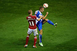 Bristol City Midfielder Joe Bryan (ENG) is challenged by Bristol Rovers Midfielder Fabian Broghammer (GER) during the first half of the match - Photo mandatory by-line: Rogan Thomson/JMP - Tel: 07966 386802 - 04/09/2013 - SPORT - FOOTBALL - Ashton Gate, Bristol - Bristol City v Bristol Rovers - Johnstone's Paint Trophy - First Round - Bristol Derby