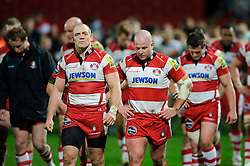 Outside Centre (#13) Mike Tindall (capt) leads replacement (#17) Nick Wood and the dejected Gloucester players round the pitch after their sides 12-18 loss during the match - Photo mandatory by-line: Rogan Thomson/JMP - Tel: Mobile: 07966 386802 05/01/2013 - SPORT - RUGBY - Kingsholm Stadium - Gloucester. Gloucester Rugby v London Irish - Aviva Premiership.
