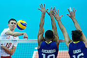 Poland's Mariusz Wlazly (left) spikes the ball while volleyball final match between Brazil and Poland during the 2014 FIVB Volleyball World Championships at Spodek Hall in Katowice on September 21, 2014.<br /> <br /> Poland, Katowice, September 21, 2014<br /> <br /> For editorial use only. Any commercial or promotional use requires permission.<br /> <br /> Mandatory credit:<br /> Photo by &copy; Adam Nurkiewicz / Mediasport