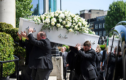 © Licensed to London News Pictures. 22/05/2018. London, UK. The coffin arrive at the church for The funeral of television presenter Dale Winton at Commonwealth Church in Marylebone, London. Dale Winton, who was found dead at his home on April 18, was famous for presenting Supermarket Sweep and National Lottery game show. Photo credit: Ben Cawthra/LNP