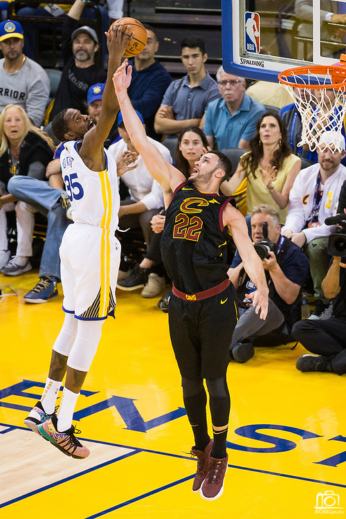 Golden State Warriors forward Kevin Durant (35) snags a rebound over Cleveland Cavaliers forward Larry Nance Jr. (22) during Game 1 of the NBA Finals at Oracle Arena in Oakland, Calif., on May 31, 2018. (Stan Olszewski/Special to S.F. Examiner)