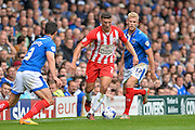 Adam Buxton runs at Enda Stevens and Jayden Stockley during the Sky Bet League 2 match between Portsmouth and Accrington Stanley at Fratton Park, Portsmouth, England on 5 September 2015. Photo by Adam Rivers.