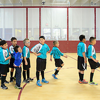 030215       Adron Gardner<br /> <br /> The Griffins and the Dragons form a line to warm up for a soccer match during the grand opening of the Harold Runnels Athletic Complex in Gallup Monday.