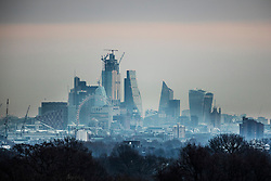 © Licensed to London News Pictures. 18/01/2019. London, UK. Seen from Richmond Park the City of London is misty at first light as freezing temperatures and snow hit parts of the UK. Photo credit: Peter Macdiarmid/LNP
