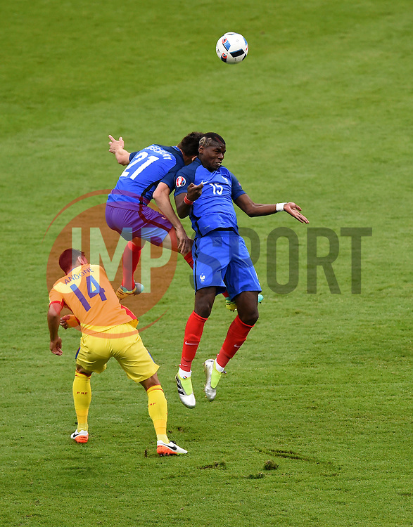 Paul Pogba of France and Laurent Koscielny of France clash heads as they jump for the same ball  - Mandatory by-line: Joe Meredith/JMP - 10/06/2016 - FOOTBALL - Stade de France - Paris, France - France v Romania - UEFA European Championship Group A