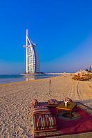 Beach, Burj Al Arab Hotel (designed to resemble a billowing sail), Dubai, United Arab Emirates