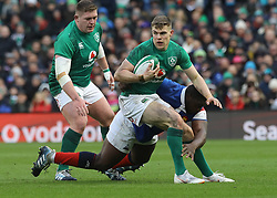 Ireland's Garry Ringrose and France's Demba Bamba (right) during the Guinness Six Nations match at the Aviva Stadium, Dublin.