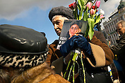 A crowd pays tribute to Russian journalist Anna Politkovskaya, six months after she was murdered in Moscow. .About 300 people gathered 7 March, 2007 on Pushkin Square to commemorate the six-month anniversary of Politkovskaya's death and to call on the authorities to bring her killer to justice..Known for her critical coverage of the war in Chechnya, she was shot to death in the elevator of her apartment building in Moscow, in a killing prosecutors believe could be connected to her investigative work..Politkovskaya was a tireless reporter who had written a critical book on Russian President Vladimir Putin and his campaign in Chechnya, documenting widespread abuse of civilians by government troops..Prosecutors have opend a murder investigation into her death, said Svetlana Petrenko, spokeswoman for the Moscow prosecutor's Office. Investigators suspect the killing was connected to the work of the 48-year-old journalist, Vyacheslav Raskinsky, Moscow's first deputy prosecutor said on state-run Rossiya television.