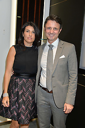 MASSIMO & STEPHANIA GISMONDI at the opening of the new Gismondi Jewellery boutique, 14 Albermarle Street, London on 9th October 2014.
