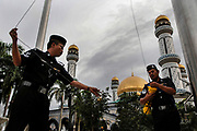 Flag ceremony at the Jame' 'Asr Hassanil Bolkiah Mosque has 29 golden domes, one for each of the Sultans of the world's oldest ruling dynasty, Bandar Seri Begawan, Brunei