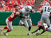 KANSAS CITY, MO - SEPTEMBER 20:   Darren McFadden #20 of the Oakland Raiders is hit by Demorrio Williams #53 of the Kansas City Chiefs at Arrowhead Stadium on September 20, 2009 in Kansas City, Missouri.  The Raiders defeated the Chiefs 13-10.  (Photo by Wesley Hitt/Getty Images) *** Local Caption *** Darren McFadden; Demorrio Williams