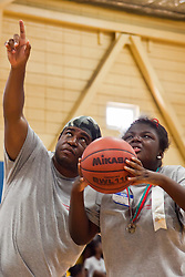 Rudel Grant encourages Shamae Rodgers during her Basketball event.