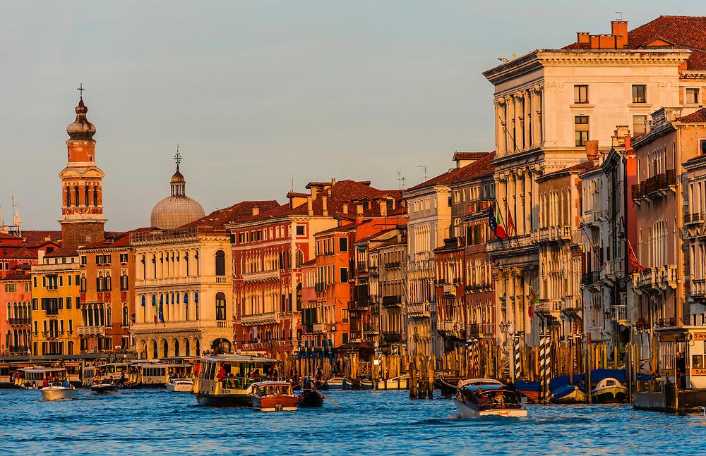 Gondolas ply the Grand Canal, Venice, Italy.