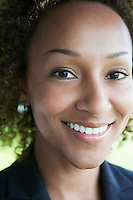 Woman smiling outdoors close-up portrait