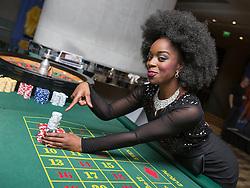 © Licensed to London News Pictures . 09/11/2013 . Manchester , UK . Cleo Higgins on the roulette table . Hearts and Minds charity ball in aid of children with autism , this evening (9th November 2013) at the Hilton Hotel on Deansgate in Manchester . Photo credit: Joel Goodman/LNP