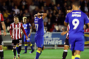 AFC Wimbledon striker Andy Barcham (17) hands on head up during the EFL Cup match between AFC Wimbledon and Brentford at the Cherry Red Records Stadium, Kingston, England on 8 August 2017. Photo by Matthew Redman.