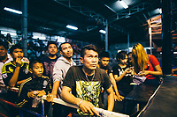 Sompon Samrong watches his son fighting in Pattaya, Thailand.