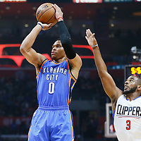 21 December 2015: Oklahoma City Thunder guard Russell Westbrook (0) takes a jump shot past Los Angeles Clippers guard Chris Paul (3) during the Oklahoma City Thunder 100-99 victory over the Los Angeles Clippers, at the Staples Center, Los Angeles, California, USA.