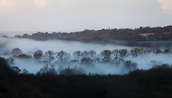 © Licensed to London News Pictures. 16/02/2014. Winchester, Hampshire, UK. Valley Fog fills the Itchen valley near Winchester, Hampshire at sunrise. The sunshine offers respite to the seemingly never ending stormy period experienced in the UK. Photo credit : Rob Arnold/LNP