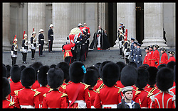The coffin of  Baroness Thatcher is taken up the steps of   St.Paul's Cathedral at the start of her funeral  in London  Wednesday 17th  April 2013 Photo by: Stephen Lock / i-Images
