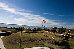 American flag flies on top of an earth mound fortification that is part of Fort Moultrie, Fort Sumter National Monument, Sullivan's Island, South Carolina, United States of America.