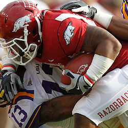 November 25, 2011; Baton Rouge, LA, USA;  LSU Tigers cornerback Ron Brooks (13) tackles Arkansas Razorbacks running back Dennis Johnson (33)during the second quarter of a game at Tiger Stadium.  Mandatory Credit: Derick E. Hingle-US PRESSWIRE