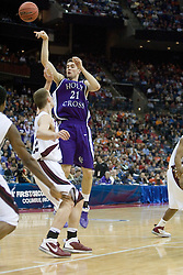 Holy Cross Crusaders forward Alex Vander Baan (21) passes over Southern Illinois Salukis forward Matt Shaw (32).  The #4 seed Southern Illinois Salukis defeated the #13 seed Holy Cross Crusaders 61-51  in the first round of the Men's NCAA Tournament in Columbus, OH on March 16, 2007.