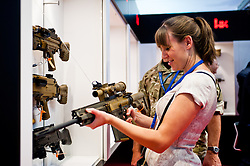 DSEI arms fair in London.<br /> A visitor looks at a rifle on display at the HK stand during the 2013 edition of DSEI at Excel London, United Kingdom. Tuesday, 10th September 2013. Picture by Piero Cruciatti / i-Images