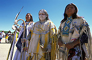 An Apache girl together with her godmother and helper at her Sunrise Dance on the San Carlos Apache Reservation, Arizona, USA. As a blessing, and an enactment of part of the Apache creation myth, the girl has been painted with white clay mixed with sacred corn meal. The Sunrise Dance, the first menstruation rite of an Apache girl, is held during the summer, within one year after the girl has had her first menstruation, and lasts for four days. During the rites the girl 'becomes' Changing Woman, a mythical female figure, and comes into possession of her healing powers. The rites are supposed to prepare the girl for adulthood and to give her a long and healthy life without material wants.