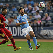 NEW YORK, NEW YORK - June 02:  Andrea Pirlo #21 of New York City FC watched by Javier Morales #11 of Real Salt Lake in action during the NYCFC Vs Real Salt Lake regular season MLS game at Yankee Stadium on June 02, 2016 in New York City. (Photo by Tim Clayton/Corbis via Getty Images)