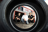 Corporate photography showing three Derby mechanics