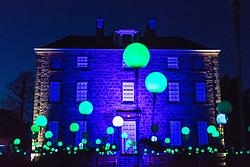 Edinburgh, Scotland, United Kingdom. 24 November, 2017. Edinburgh's newest festive event, Christmas at the Botanics, opened this evening . The illuminations held inside Edinburgh's Royal Botanic Gardens runs for 29 nights. Inverleith House with spheres of light in the Bloom display.