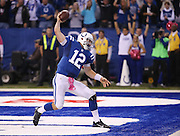 Indianapolis Colts Andrew Luck spikes the ball after a big fourth quarter touchdown run against the Ravens. Indianapolis hosted Baltimore at Lucas Oil Stadium Sunday, October 5, 2014.