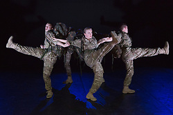 "© Licensed to London News Pictures. 07/05/2015. London, England. The company perform the Helicopter Dance. The Rosie Kay Dance Company perform ""5 Soldiers: The Body is the Frontline"" at The Rifles Officers' Club in Mayfair, London from 7 to 9 May 2015 before continuing a UK tour. 5 Soldiers gives an intimate view of the training that provides soldiers for combat and warfare and how the experience affects those that put their life on the line. Dancers: Duncan Anderson, Shelley Eva Haden, Chester Hayes, Sean Marcs and Oliver Russell. Choreographed and directed by Rosie Kay.  Photo credit: Bettina Strenske/LNP"