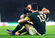Sonny Bill Williams comforts South African centre Jesse Kriel as he sits dejected at the end of the match. Rugby World Cup Semi Final, South Africa v New Zealand All Blacks, Twickenham Stadium, London, England. Saturday 24 October 2015. Copyright Photo: Andrew Cornaga / www.Photosport.nz