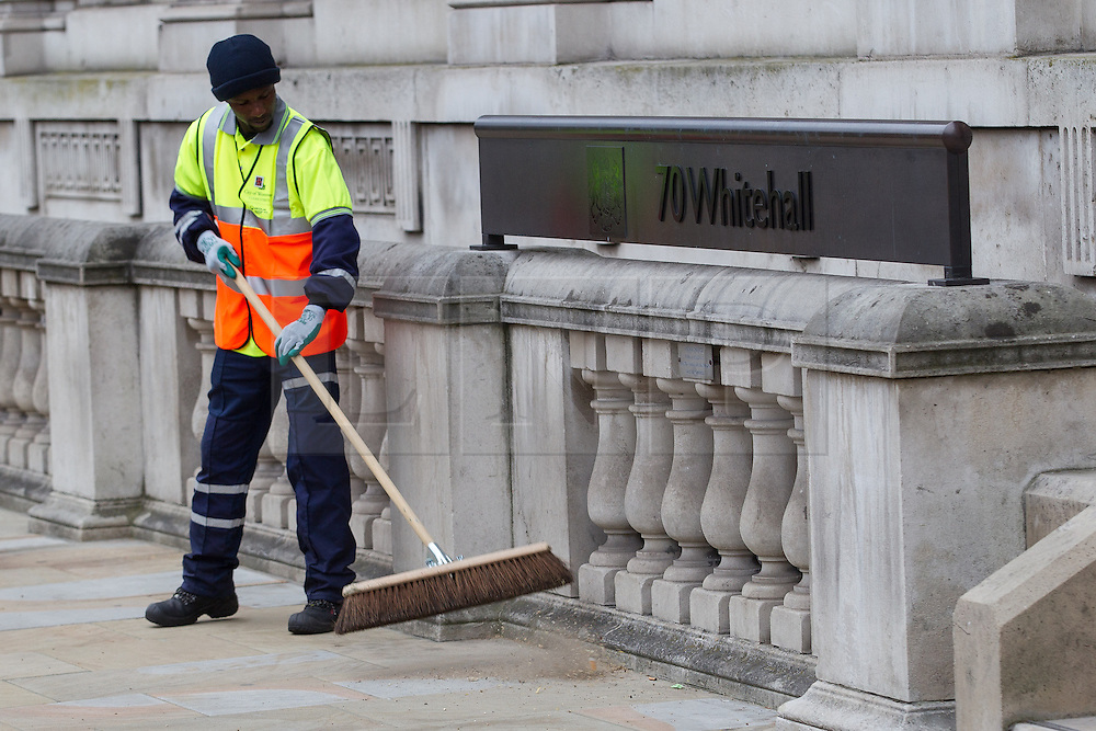 © Licensed to London News Pictures . 17/04/2013 . London , UK . Street sweepers clean the pavement along Whitehall in preparation for the funeral procession . The funeral of former British Conservative Prime Minister , Baroness Margaret Thatcher , today (Wednesday 17th April 2013) in Central London . Baroness Thatcher died from a stroke at the age of 87 . Photo credit : Joel Goodman/LNP