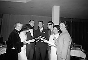 """At a restaurant on the 11th floor of the O'Connell Bridge House, the Miami Showband host a reception for their latest release, """"Wishing it was you"""", and also to mark their third anniversary of the group as a professional showband..29.11.1965"""