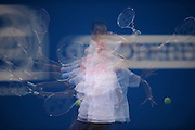 Brisbane, Australia, December 30: **EDITOR NOTE: This image has be mutiple exposed x10 in camera.** Bernard Tomic of Australia plays a forehand shot during a training session at Pat Rafter Arena ahead of the 2012 Brisbane International Tennis Tournament in Brisbane, Australia on Friday December 30th, 2011. (Photo: Matt Roberts/Photo News)