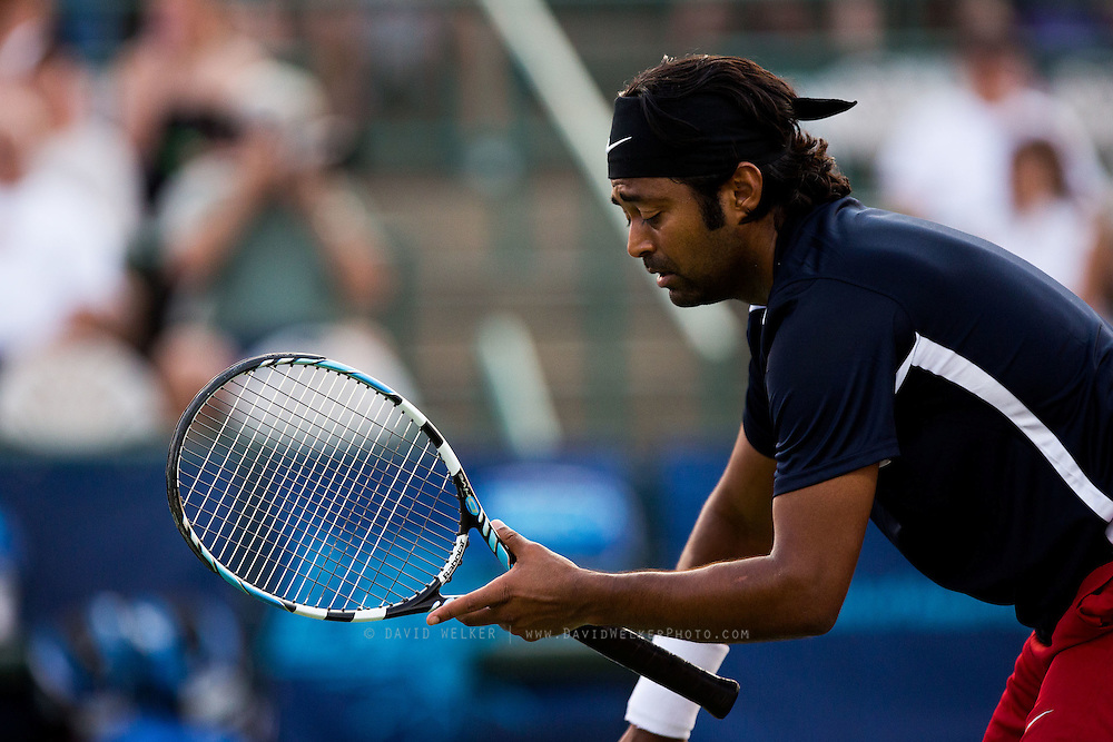 Leander Paes of the Washington Kastles messes with his racket during a match against the Springfield Lasers at Mediacom Stadium on July 11, 2012 in Springfield, Missouri. (David Welker/www.Turfimages.com).