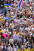 "09 MAY 2014 - BANGKOK, THAILAND:  Thai anti-government protestors march through the streets of Bangkok. Thousands of Thai anti-government protestors took to the streets of Bangkok Friday to start their ""final push"" to bring the popularly elected of government of Yingluck Shinawatra. Yingluck has already been forced out by a recent court ruling that forced her to resign and she is facing indictment by the National Anti Corruption Commission of Thailand for alleged improprieties related to a government rice price support scheme. The protestors Friday were marching to demand that she not be allowed to return to politics. The courts have not banned her party, Pheu Thai, which has formed an interim caretaker government to govern until elections expected in July, 2014. Suthep Thaugsuban, secretary-general of the People's Democratic Reform Committee (PDRC),  said the president of the Supreme Court and the new senate speaker, who would be selected Friday, should set up an ""interim people's government and legislative assembly."" He went onto say that if they didn't, he would.    PHOTO BY JACK KURTZ"